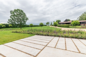 new patio area with view over landscaped garden