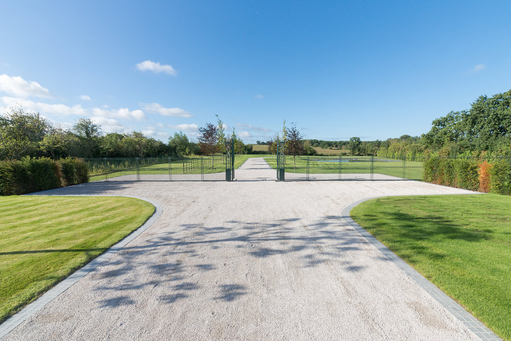 long commercial gravel driveway and gates