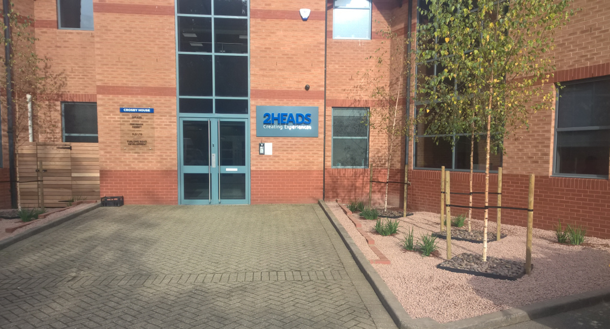 trees planted at entrance to business