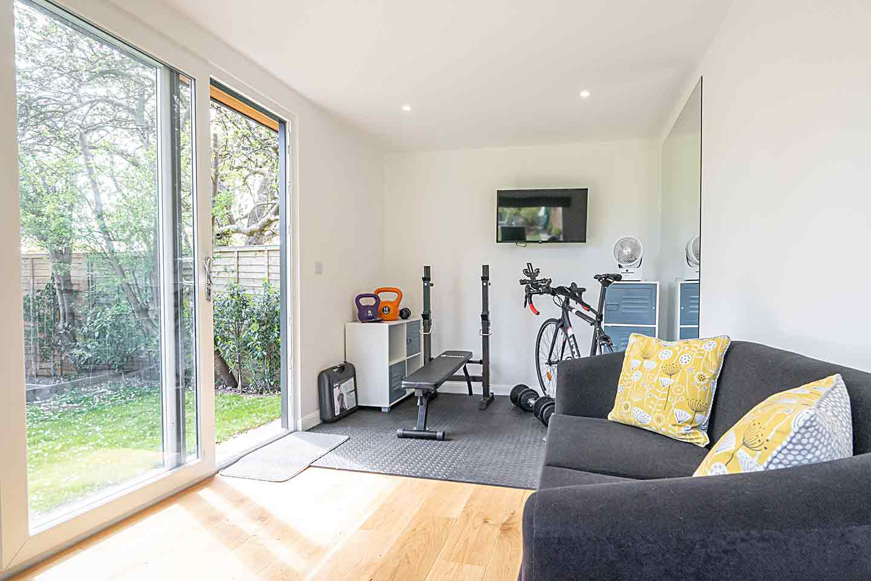 Garden office with gym equipment