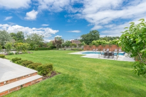 landscaped garden with patio and outdoor pool