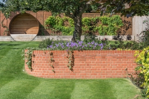 elevated flowerbed in residential landscaped garden