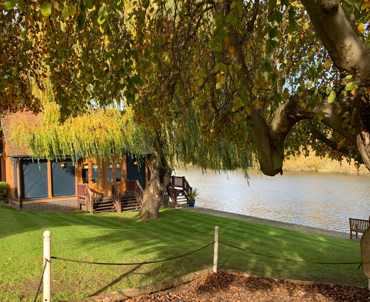 well maintained lawn running down to the Thames