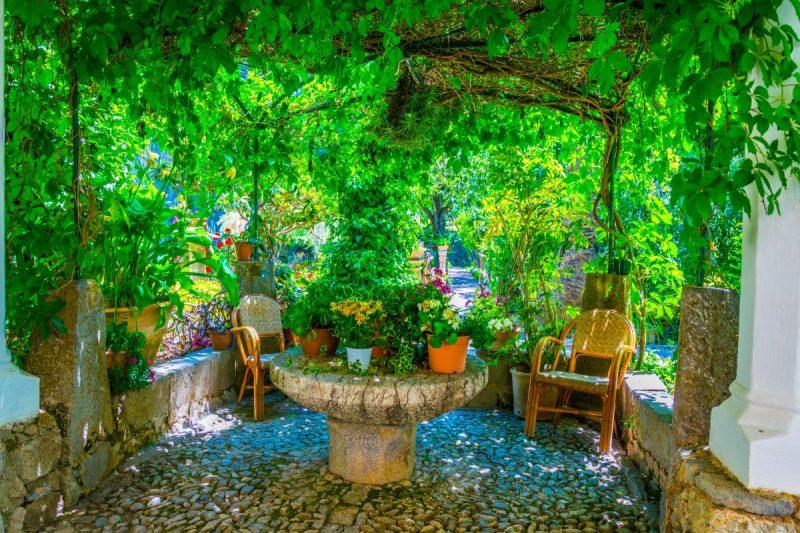 pergola over seating area in Mediterranean garden